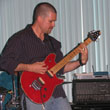 Photo of adult guitar student Roy Hetherington performing his own composition in the Student Rock Recital March 2006 at The Golden Lotus in Rancho Palos Verdes