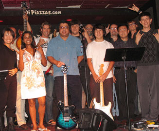 Photo of teen and adult piano guitar bass drum voice students at the Student Rock Concert at diPiazzas in Long Beach, California