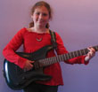 Photo of our most enthusiastic girl Casey with guitar in the lobby of South Bay School of Music Redondo Beach California CA